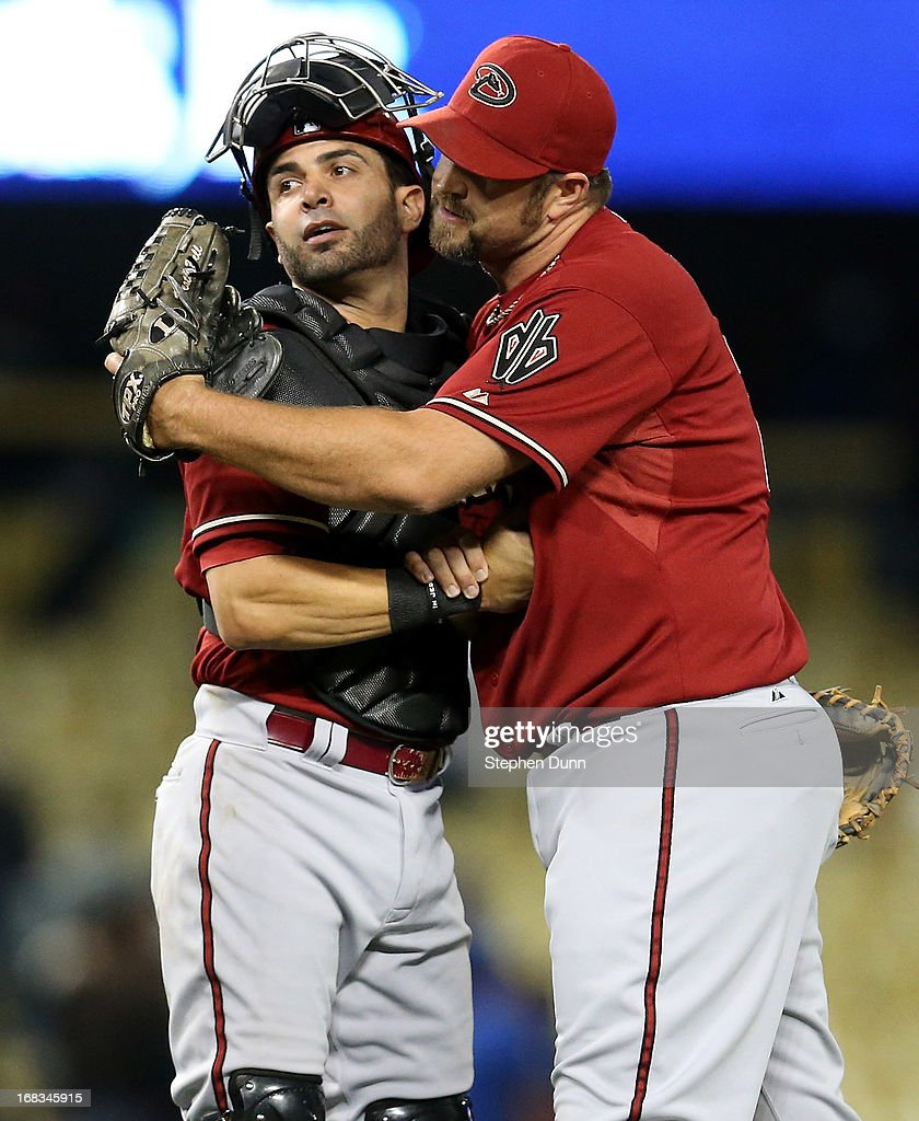 Closer Heath Bell #21 and catcher Wil Nieves #27 of the Arizona Diamondbacks celebrate after Bell picked up the save against the Los Angeles Dodgers at Dodger Stadium on May 8, 2013 in Los Angeles, California. The Diamondbacks won 3-2.