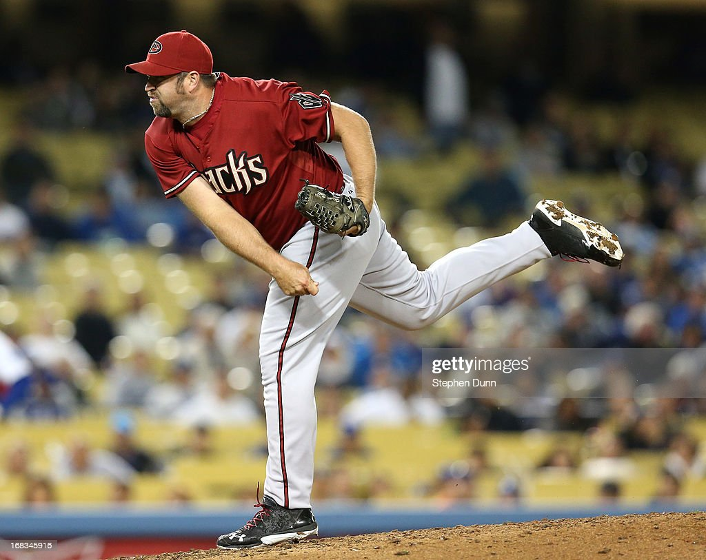 Closer <a gi-track='captionPersonalityLinkClicked' href=/galleries/search?phrase=Heath+Bell&family=editorial&specificpeople=243211 ng-click='$event.stopPropagation()'>Heath Bell</a> #21 of the Arizona Diamondbacks throws a pitch in the ninth inning on his way tol picking up the save against the Los Angeles Dodgers at Dodger Stadium on May 8, 2013 in Los Angeles, California. The Diamondbacks won 3-2.