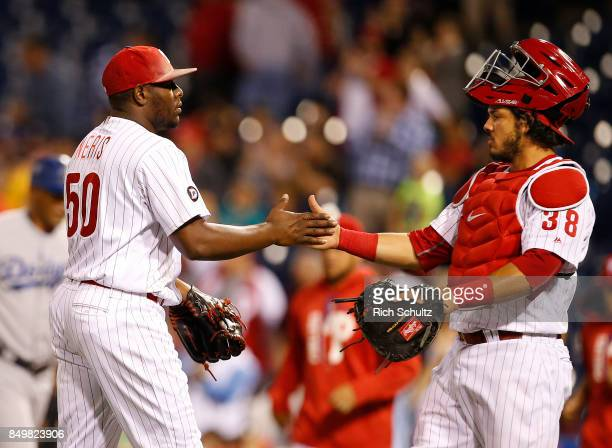 Closer Hector Neris is congratulated by catcher Jorge Alfaro of the Philadelphia Phillies after defeating the Los Angeles Dodgers 62 during a game at...