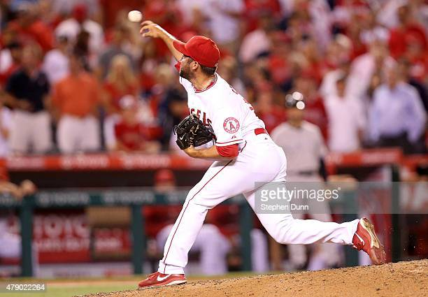 Closer Huston Street of the Los Angeles Angels of Anaheim celebrate after Street throws a pitch in the ninth inning on his way to picking up the save...