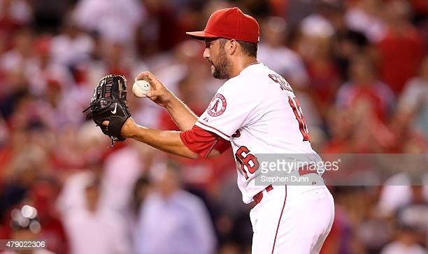 Closer Huston Street of the Los Angeles Angels of Anaheim prepares to throw a pitch in the ninth inning on his way to picking up the save against the...