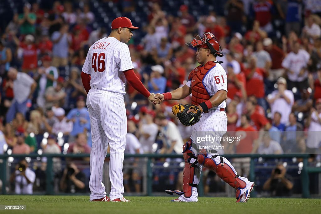 Closer Jeanmar Gomez #46 of the Philadelphia Phillies shakes hands with catcher Carlos Ruiz #51 after saving a game against the Miami Marlins at Citizens Bank Park on July 20, 2016 in Philadelphia, Pennsylvania. The Phillies won 4-1.