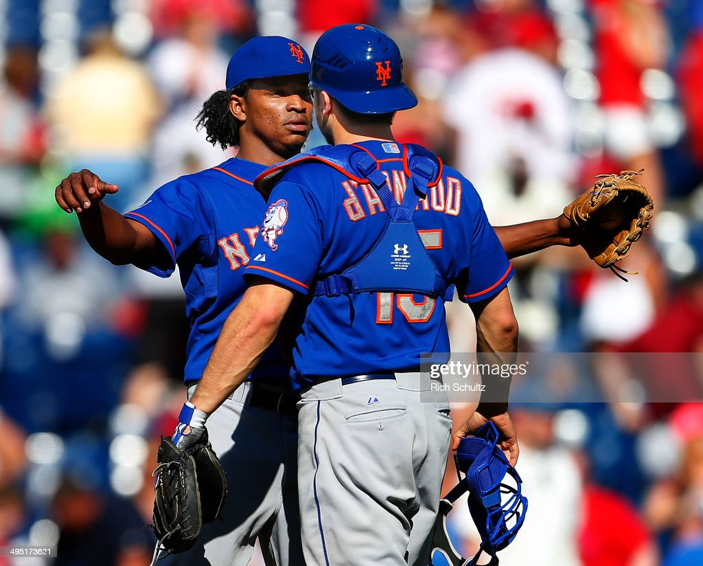 Closer Jenrry Mejia #58 of the New York Mets chest bumps Travis d'Arnaud #15 after getting the final out as the Mets defeat the Philadelphia Phillies 4-3 in eleven innings in a game at Citizens Bank Park on June 1, 2014 in Philadelphia, Pennsylvania.