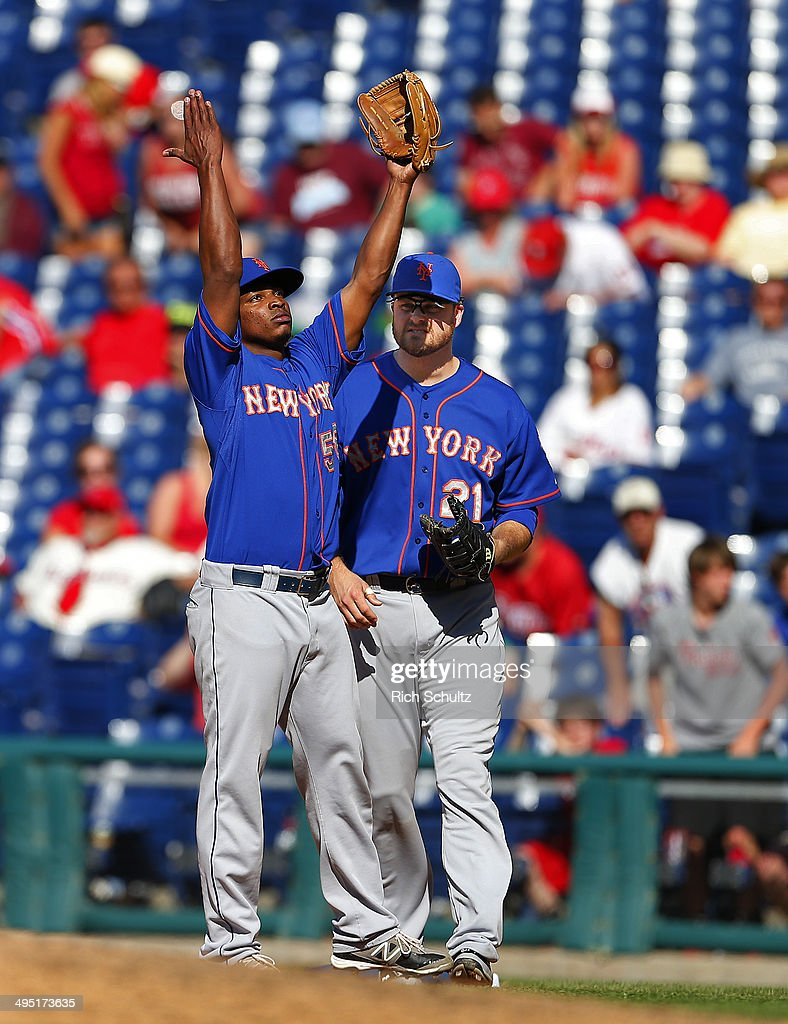 Closer Jenrry Mejia #58 of the New York Mets raises his arms alongside <a gi-track='captionPersonalityLinkClicked' href=/galleries/search?phrase=Lucas+Duda&family=editorial&specificpeople=7172550 ng-click='$event.stopPropagation()'>Lucas Duda</a> #21 after getting the final out as the Mets defeat the Philadelphia Phillies 4-3 in eleven innings in a game at Citizens Bank Park on June 1, 2014 in Philadelphia, Pennsylvania.