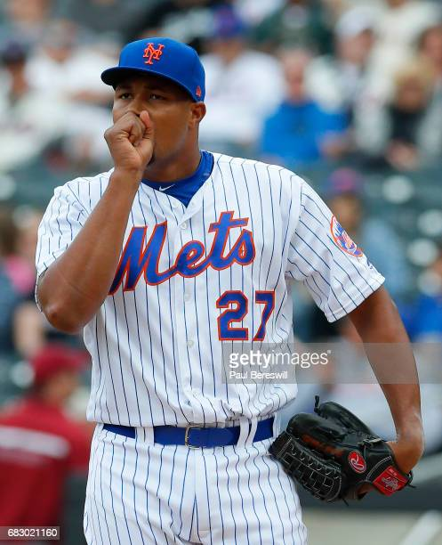Closer Jeurys Familia of the New York Mets blows on his hand in the ninth inning in an MLB baseball game against the San Francisco Giants on May 10...