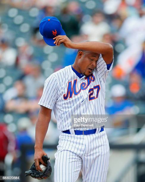 Closer Jeurys Familia of the New York Mets reacts after giving up three runs in the ninth inning in an MLB baseball game against the San Francisco...