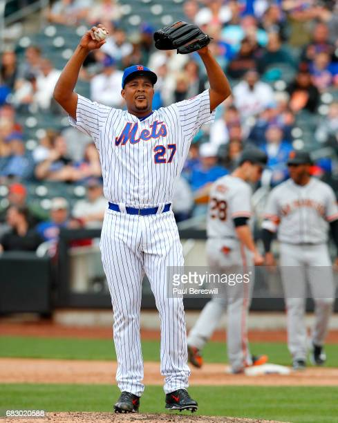 Closer Jeurys Familia of the New York Mets reacts as he stretches out between pitches in the ninth inning in an MLB baseball game against the San...