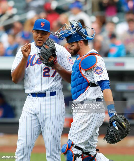 Closer Jeurys Familia of the New York Mets talks with catcher Kevin Plawecki in the ninth inning in an MLB baseball game against the San Francisco...