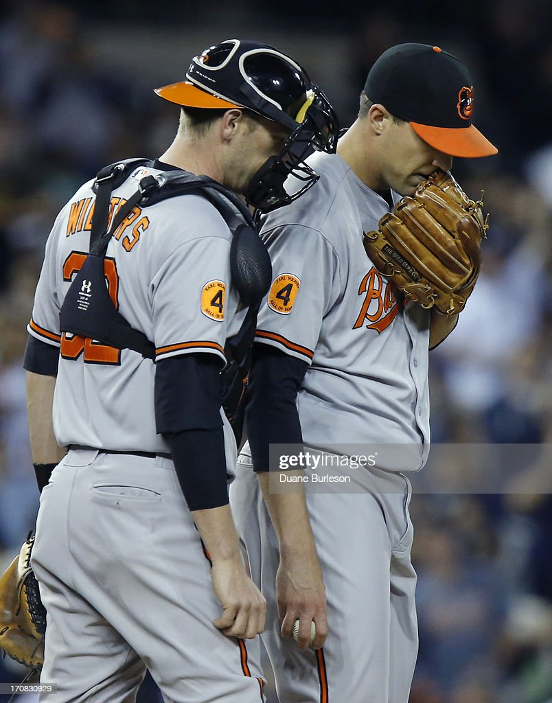 Closer Jim Johnson #43 of the Baltimore Orioles talks with catcher <a gi-track='captionPersonalityLinkClicked' href=/galleries/search?phrase=Matt+Wieters&family=editorial&specificpeople=4498276 ng-click='$event.stopPropagation()'>Matt Wieters</a> #32 before pitching to Miguel Cabrera of the Detroit Tigers in the ninth inning at Comerica Park on June 18, 2013 in Detroit, Michigan. Cabrera hit into a double play to end the game. The Orioles defeated the Tigers 5-2.