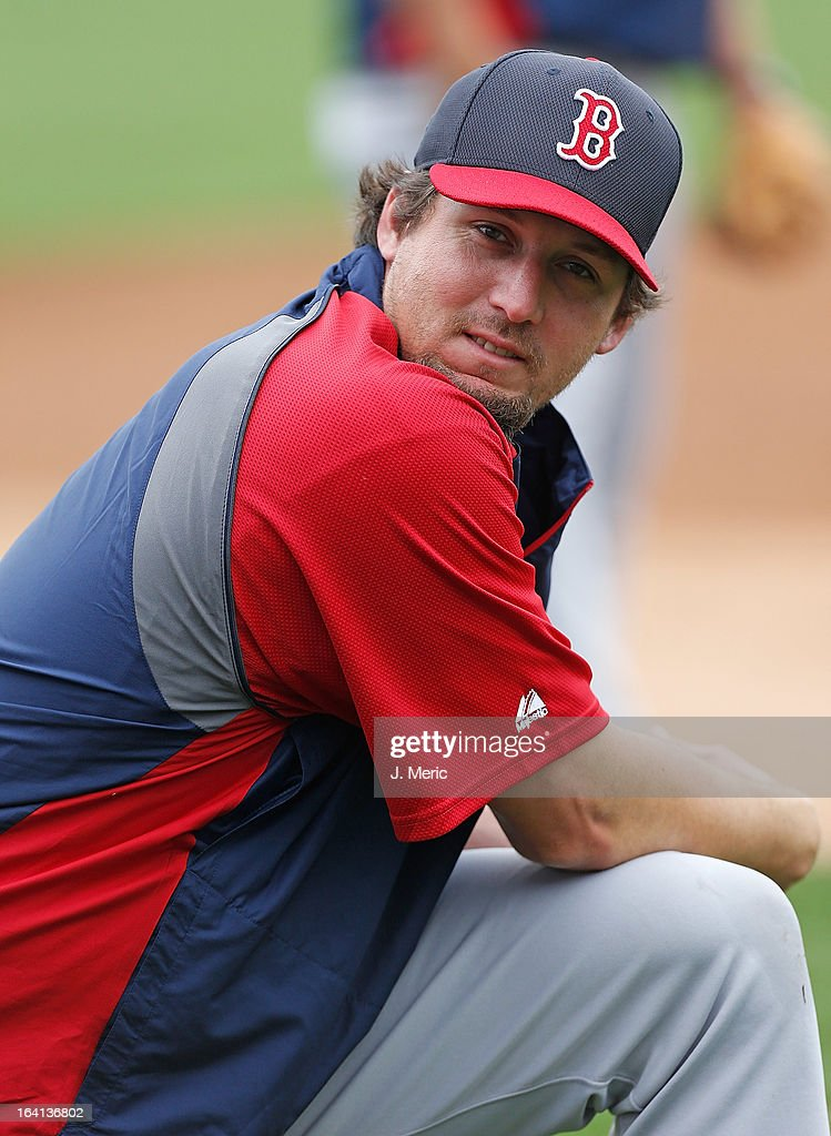 Closer Joel Hanrahan of the Boston Red Sox stretches just before the start of the Grapefruit League Spring Training Game against the New York Yankees...