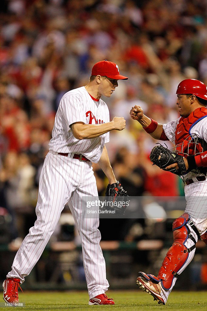 Closer <a gi-track='captionPersonalityLinkClicked' href=/galleries/search?phrase=Jonathan+Papelbon&family=editorial&specificpeople=453535 ng-click='$event.stopPropagation()'>Jonathan Papelbon</a> #58 of the Philadelphia Phillies is congratulated by Carlos Ruiz #51 after winning the game against the Boston Red Sox at Citizens Bank Park on May 18, 2012 in Philadelphia, Pennsylvania. The Phillies won 6-4.