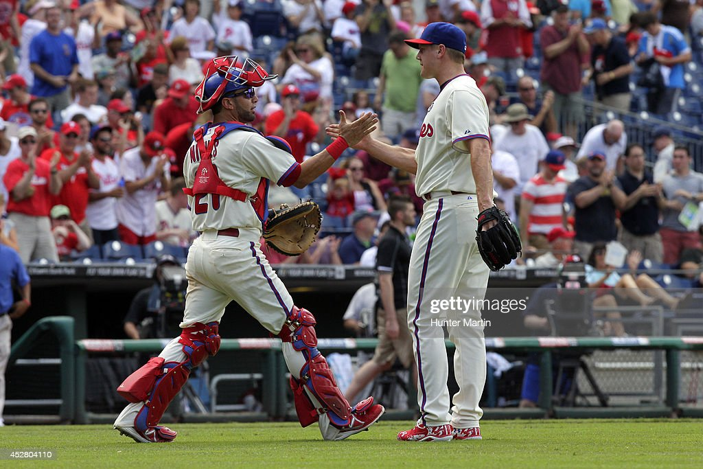Closer <a gi-track='captionPersonalityLinkClicked' href=/galleries/search?phrase=Jonathan+Papelbon&family=editorial&specificpeople=453535 ng-click='$event.stopPropagation()'>Jonathan Papelbon</a> #58 of the Philadelphia Phillies is congratulated by <a gi-track='captionPersonalityLinkClicked' href=/galleries/search?phrase=Wil+Nieves&family=editorial&specificpeople=835752 ng-click='$event.stopPropagation()'>Wil Nieves</a> #21 after saving a game against the Arizona Diamondbacks at Citizens Bank Park on July 27, 2014 in Philadelphia, Pennsylvania. The Phillies won 4-2.