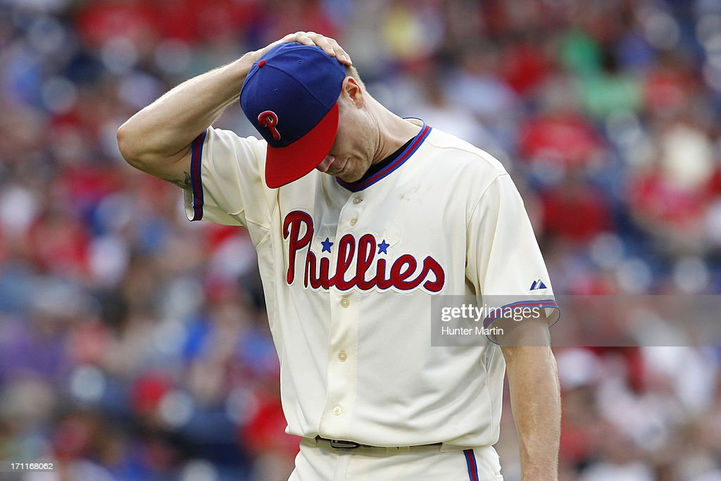Closer Jonathan Papelbon #58 of the Philadelphia Phillies walks back to the dugout after giving up the lead in the ninth inning of a game against the New York Mets at Citizens Bank Park on June 22, 2013 in Philadelphia, Pennsylvania. The Phillies won 8-7.