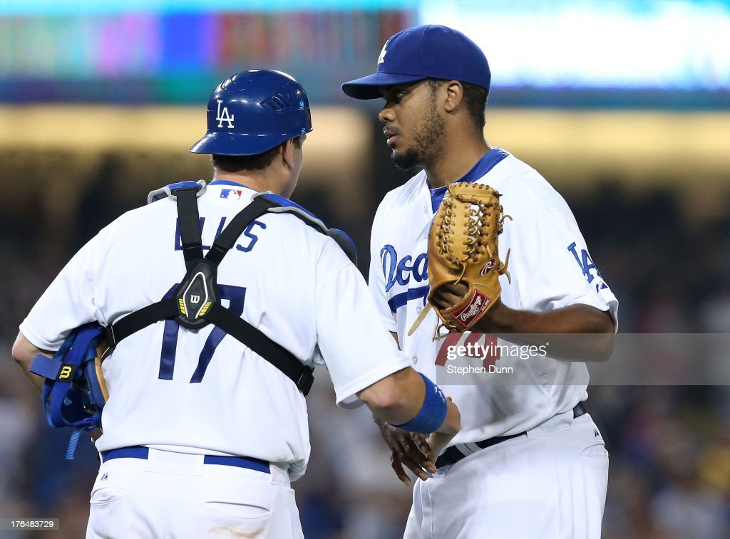 Closer <a gi-track='captionPersonalityLinkClicked' href=/galleries/search?phrase=Kenley+Jansen&family=editorial&specificpeople=5751411 ng-click='$event.stopPropagation()'>Kenley Jansen</a> #74 and catcher A.J. Ellis #17 of the Los Angeles Dodgers celebrate after Jansen picked up the save against the New York Mets at Dodger Stadium on August 13, 2013 in Los Angeles, California. The Dodgers won 4-2.