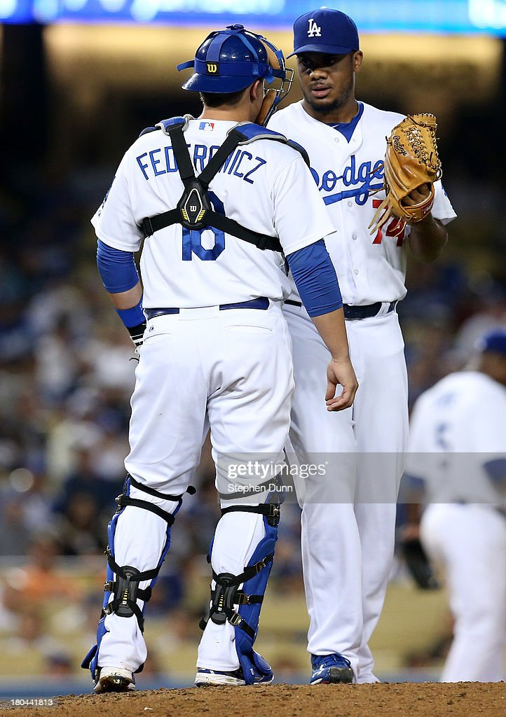 Closer <a gi-track='captionPersonalityLinkClicked' href=/galleries/search?phrase=Kenley+Jansen&family=editorial&specificpeople=5751411 ng-click='$event.stopPropagation()'>Kenley Jansen</a> #74 and catcher Tim Federowicz #18 of the Los Angeles Dodgers confer on the mound during the ninth inning against the San Francisco Giants at Dodger Stadium on September 12, 2013 in Los Angeles, Jansen gave up a run in the inning for a blown save.
