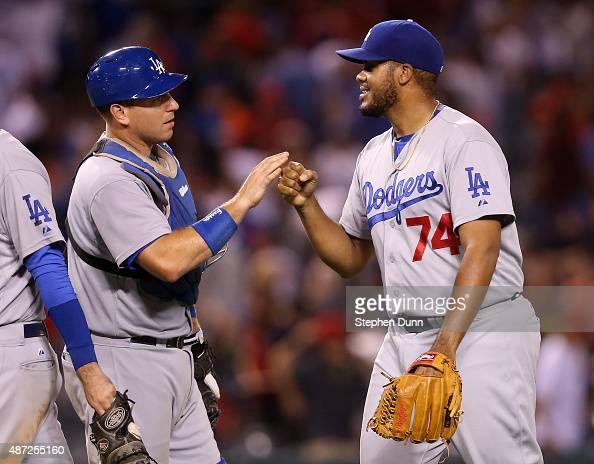 Closer Kenley Jansen of the Los Angeles Dodgers celebrates with catcher AJ Ellis after pitching the ninth inning for the save against the Los Angeles...
