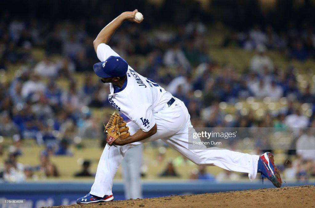 Closer <a gi-track='captionPersonalityLinkClicked' href=/galleries/search?phrase=Kenley+Jansen&family=editorial&specificpeople=5751411 ng-click='$event.stopPropagation()'>Kenley Jansen</a> #74 of the Los Angeles Dodgers pitches the ninth inning on his way to getting the save against the New York Mets at Dodger Stadium on August 13, 2013 in Los Angeles, California. The Dodgers won 4-2.