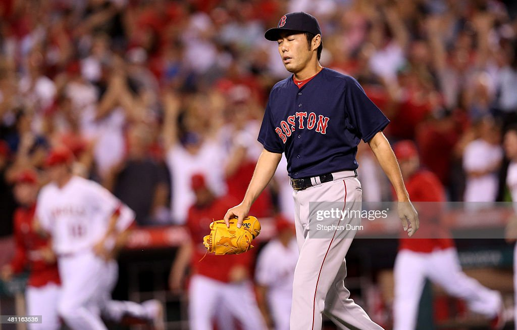 Closer Koji Uehara#19 of the Boston Red Sox reacts as he heads to the dugout after giving up a game winning walk off home run to Mike Trout #27 of the Los Angeles Angels of Anaheim in the ninth inning at Angel Stadium of Anaheim on July 17, 2015 in Anaheim, California. The Angels won 1-0.