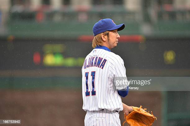 Closer Kyuji Fujikawa of the Chicago Cubs pitches during the ninth inning against the San Francisco Giants at Wrigley Field on April 12 2013 in...