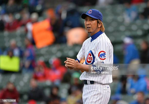 Closer Kyuji Fujikawa of the Chicago Cubs stands on the mound during the ninth inning against the San Francisco Giants at Wrigley Field on April 12...