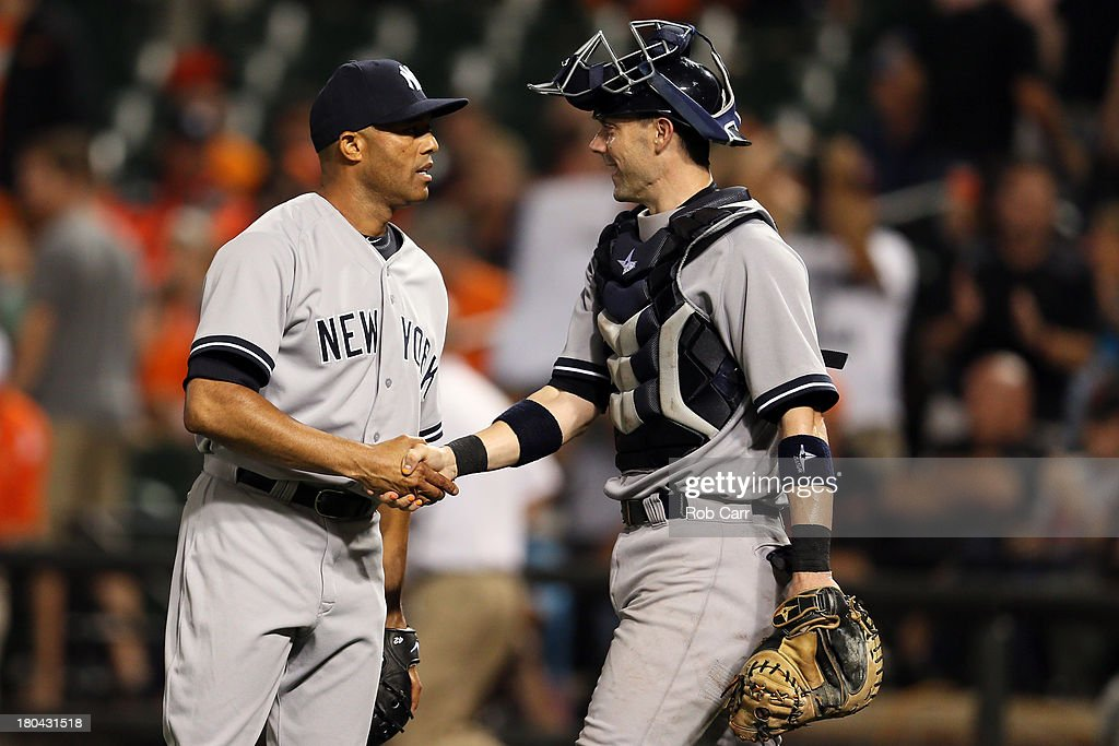Closer <a gi-track='captionPersonalityLinkClicked' href=/galleries/search?phrase=Mariano+Rivera&family=editorial&specificpeople=201607 ng-click='$event.stopPropagation()'>Mariano Rivera</a> #42 and catcher Chris Stewart #19 of the New York Yankees celebrate following the Yankees 6-5 win over the Baltimore Orioles at Oriole Park at Camden Yards on September 12, 2013 in Baltimore, Maryland.