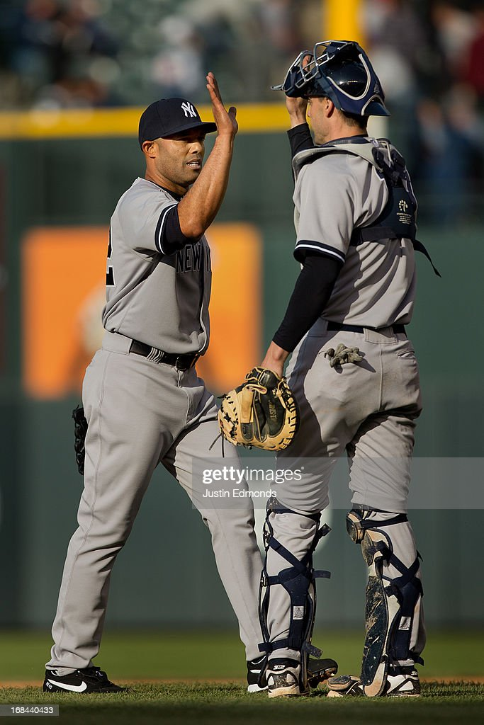 Closer <a gi-track='captionPersonalityLinkClicked' href=/galleries/search?phrase=Mariano+Rivera&family=editorial&specificpeople=201607 ng-click='$event.stopPropagation()'>Mariano Rivera</a> #42 of the New York Yankees celebrates with catcher Chris Stewart #19 after recording the final out of the game against the Colorado Rockies at Coors Field on May 9, 2013 in Denver, Colorado. The Yankees defeated the Rockies 3-1 to win the series.