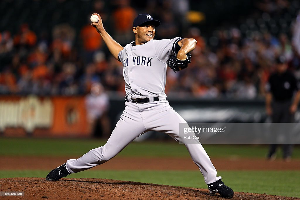 Closer <a gi-track='captionPersonalityLinkClicked' href=/galleries/search?phrase=Mariano+Rivera&family=editorial&specificpeople=201607 ng-click='$event.stopPropagation()'>Mariano Rivera</a> #42 of the New York Yankees throws to a Baltimore Orioles batter during the ninth inning of the Yankees 6-5 win at Oriole Park at Camden Yards on September 12, 2013 in Baltimore, Maryland.