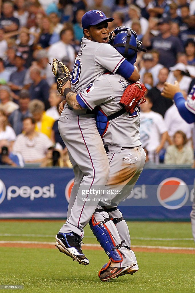 Closer <a gi-track='captionPersonalityLinkClicked' href=/galleries/search?phrase=Neftali+Feliz&family=editorial&specificpeople=5753005 ng-click='$event.stopPropagation()'>Neftali Feliz</a> #30 of the Texas Rangers celebrates with catcher <a gi-track='captionPersonalityLinkClicked' href=/galleries/search?phrase=Mike+Napoli&family=editorial&specificpeople=525007 ng-click='$event.stopPropagation()'>Mike Napoli</a> #25 after the Rangers defeat the Tampa Bay Rays 4-3 in Game Four of the American League Division Series at Tropicana Field on October 4, 2011 in St Petersburg, Florida.