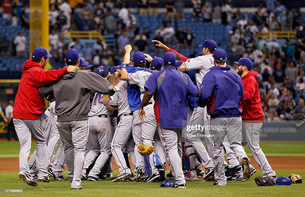 Closer Neftali Feliz #30 of the Texas Rangers celebrates with catcher Mike Napoli #25 and the rest of their teammates after the Rangers defeat the Tampa Bay Rays 4-3 in Game Four of the American League Division Series at Tropicana Field on October 4, 2011 in St Petersburg, Florida. The Rangers victory sends them to the American League Championship Series.