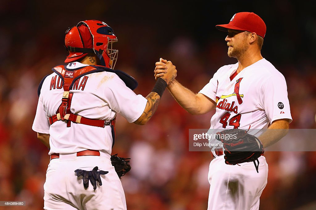 Closer Trevor Rosenthal #44 and Yadier Molina #4 of the St. Louis Cardinals celebrate after beating the San Francisco Giants at Busch Stadium on August 17, 2015 in St. Louis, Missouri.
