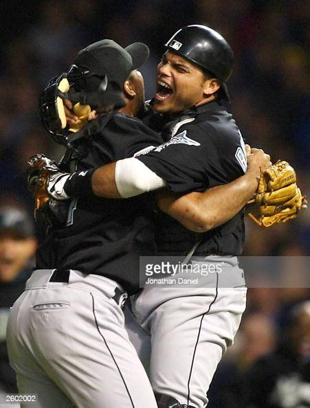 Closer Ugueth Urbina of the Florida Marlins celbrates with catcher Ivan Rodriguez after the final out against the Chicago Cubs during game seven of...