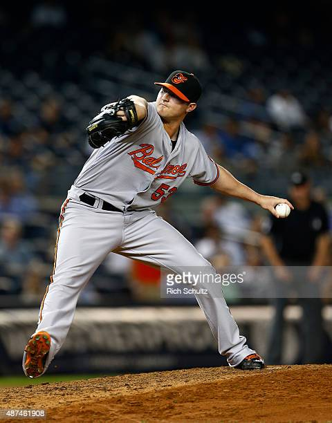 Closer Zach Britton of the Baltimore Orioles delivers a pitch against the New York Yankees in a MLB baseball game at Yankee Stadium on September 9...