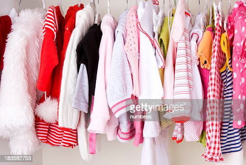 A closet that's full of baby's clothing