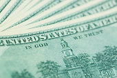 close-up 100 US dollar bills with in God we trust text. Background