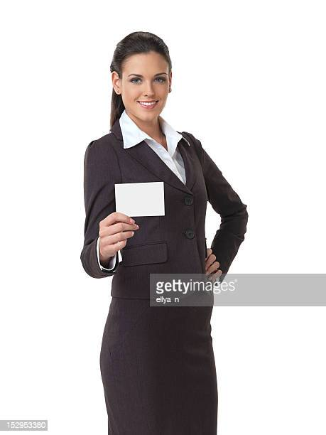 Close-up a business woman pointing at white card