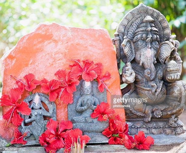 Close-up a statue of God Ganesha with Goddess Durga