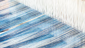 Closeup, abstract motion blur of silk fabric weaving