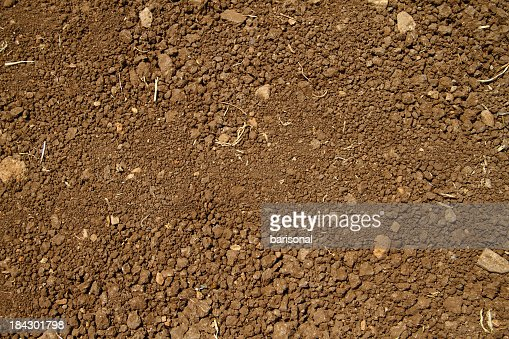 Close-up aerial view of coarse brown soil with no plant life
