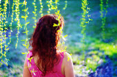 Closeup back view of redhaired woman outdoors