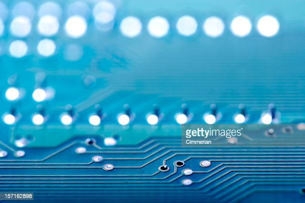 Close-up background image of a blue circuit board