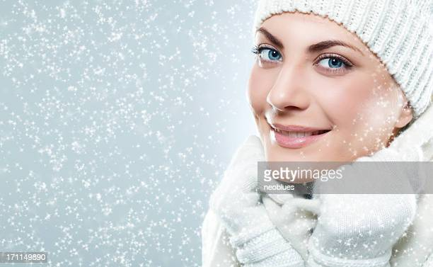 Close-up beautiful face of  woman with white sweater and cap