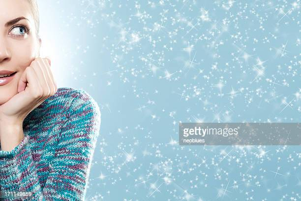 Close-up beautiful face of young woman with blue sweater