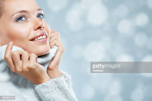 Close-up beautiful face of young woman with white sweater