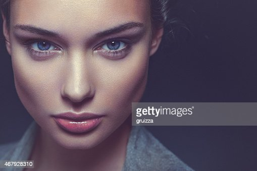 Close-up, beauty portrait of a confident, beautiful brunette woman
