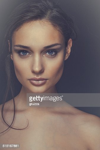 Close-up, beauty portrait of a smiling, beautiful brunette woman