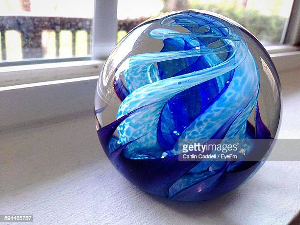 Close-Up Blue Marble Ball On Window Sill