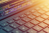 Closeup coding on screen, hands coding html and programming on screen laptop, web development, developer