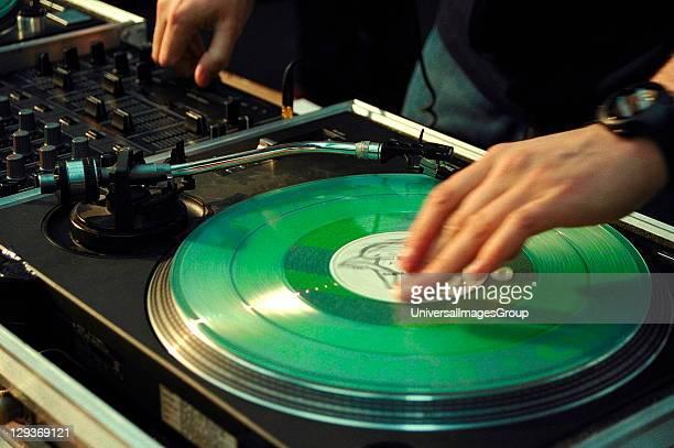 Closeup detail of a DJ mixing on Technics record decks UK 2000's
