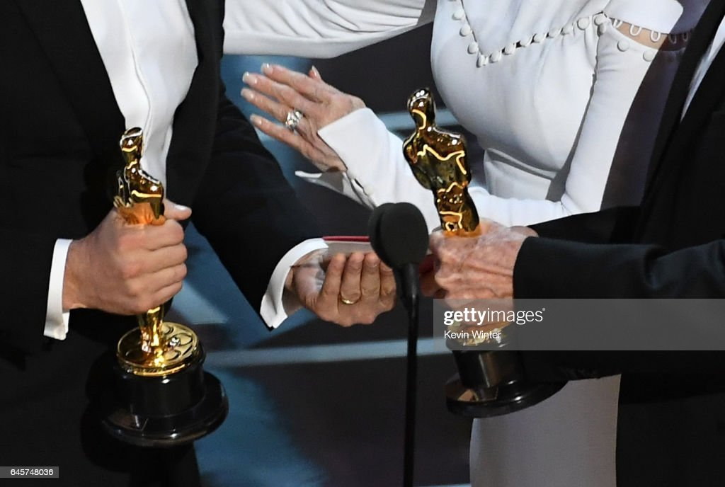 Closeup detail shot of Oscar statuettes as 'La La Land' producer Jordan Horowitz (L) accepts Best Picture after a presentation error (later awarded to 'Moonlight') with actor Warren Beatty onstage during the 89th Annual Academy Awards at Hollywood & Highland Center on February 26, 2017 in Hollywood, California.