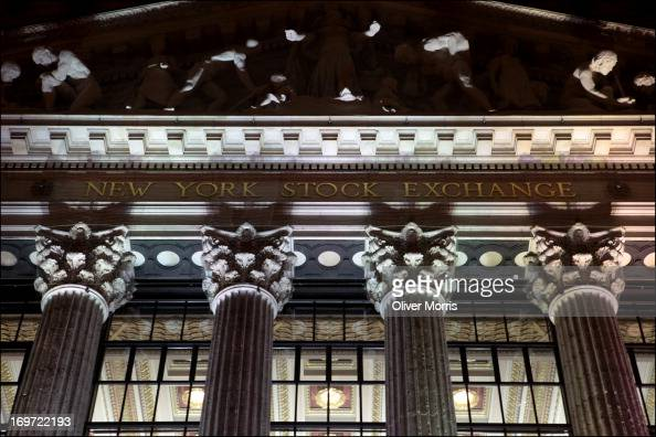 Closeup exterior nighttime view of the New York Stock Exchange which features columns with Corinthian capitals Lower Manhattan New York New York...
